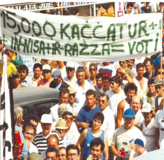 Hunters using their vote as a bargaining chip in 1993 during a protest. The banner reads '15,000 hunters + wives + extended kin = votes'. This led to hunting laws being relaxed prior to the 1996 general election. If this has happened before, who will say it has not or will not happen again? (Source: Falzon, M.A. (2008). Flights of Passion: Hunting, ecology and politics in Malta and the Mediterranean. Anthropology Today, 24 (1), pp. 15-20.)